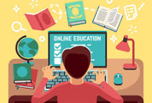 Clip Art-Male Student looking at a laptop on a desk with books, a globe and light
