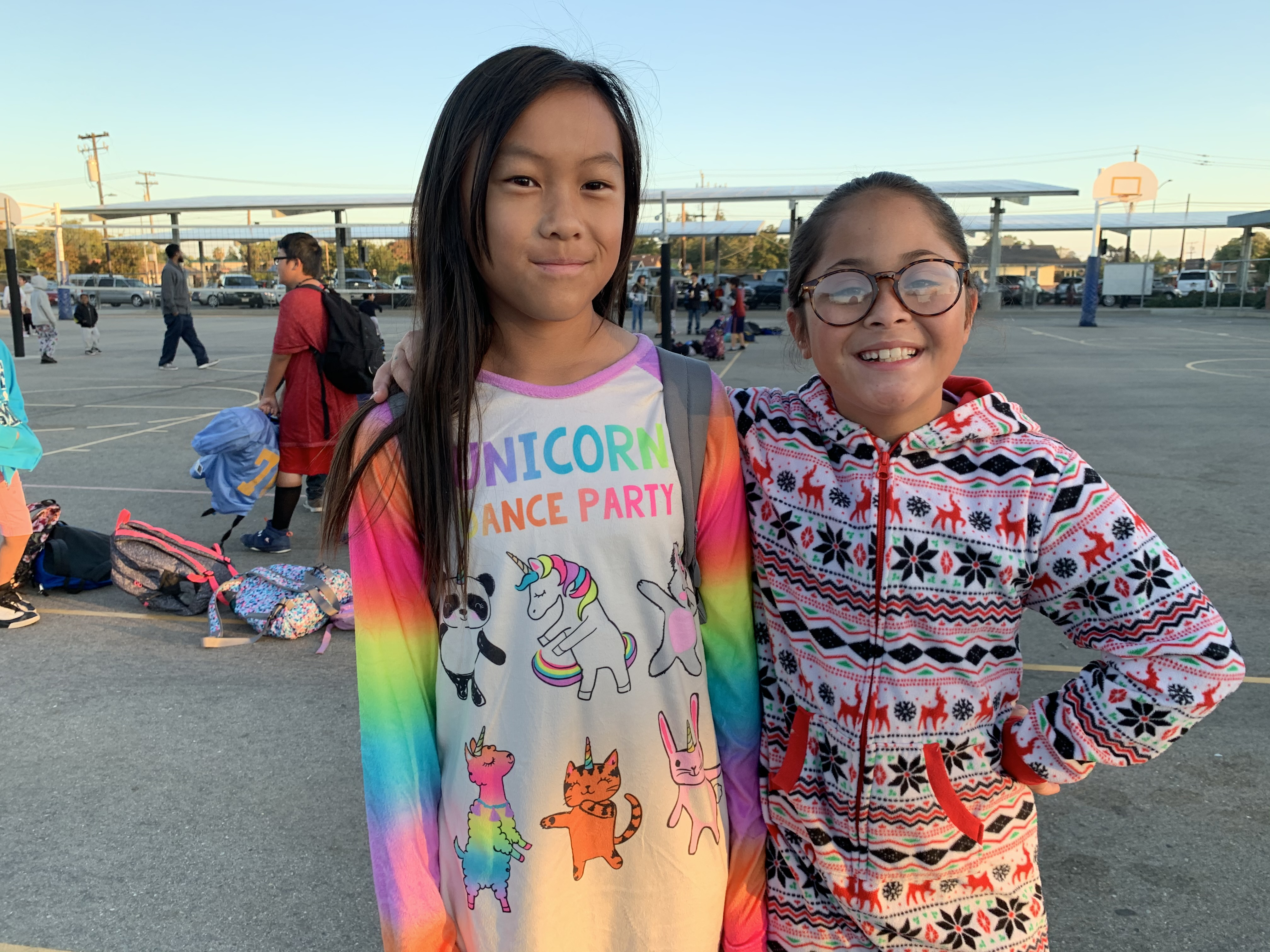 """Two female students on """"PJ Day"""""""